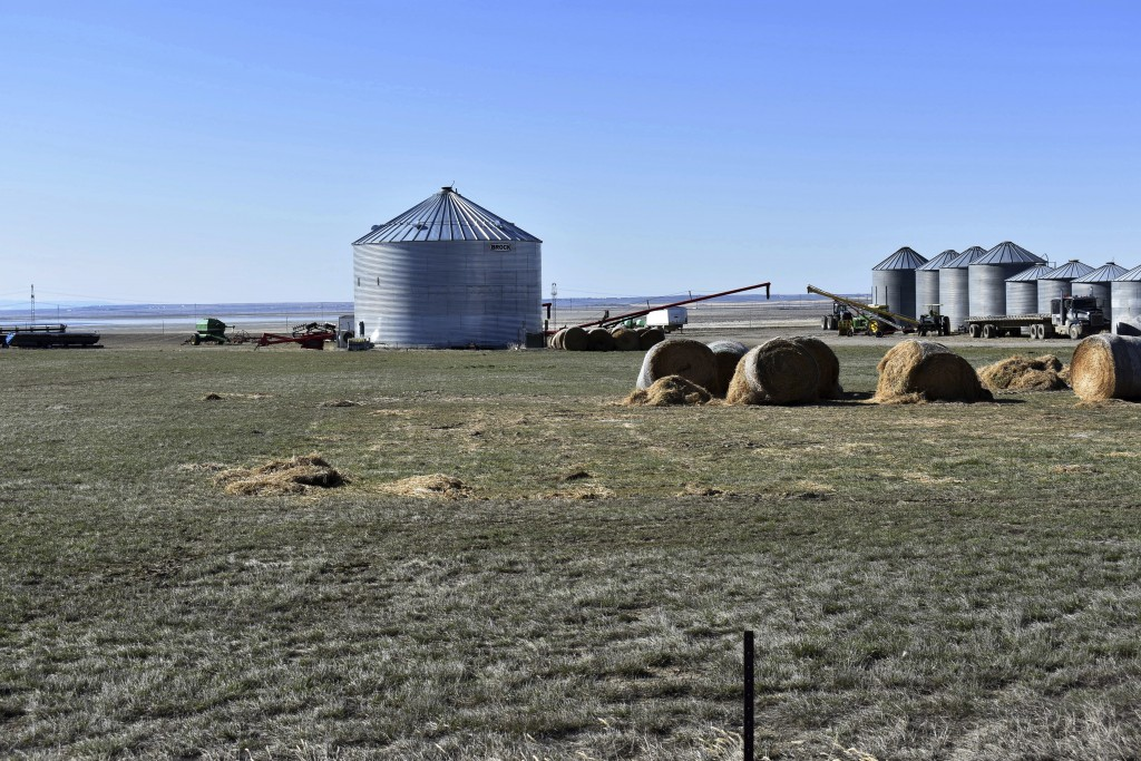 This April 20, 2018, photo shows grain silos at Erickson Farm in Broadview, Mont. Deep in Montana's ag country, ranchers' and farmers' support of Pres...