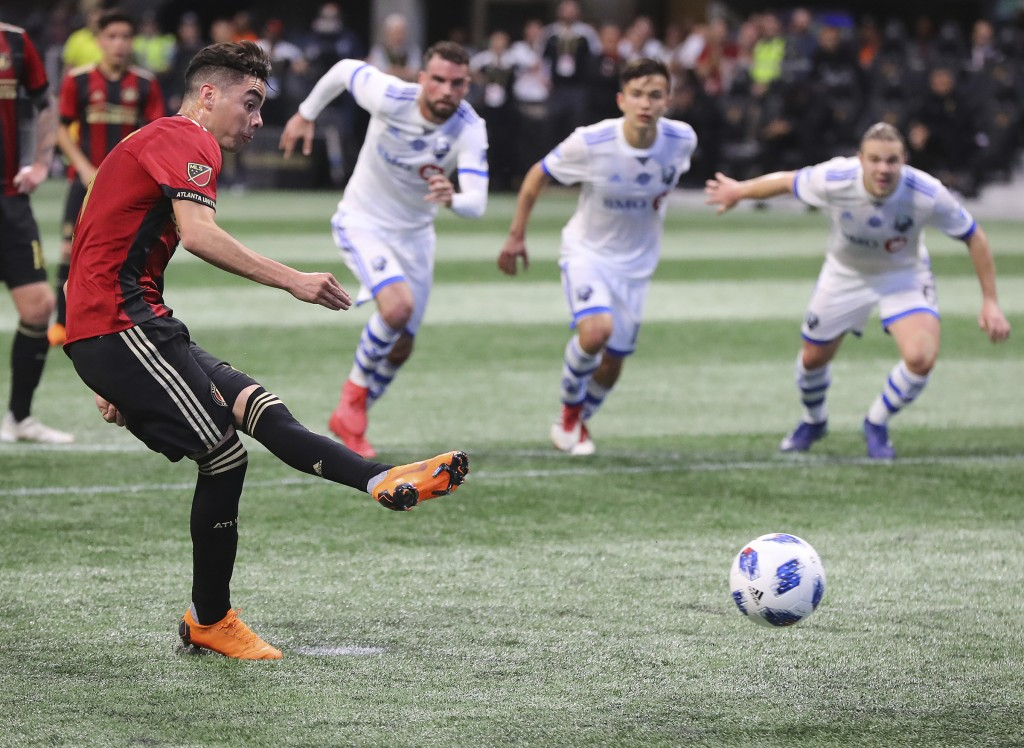 Atlanta United midfielder Miguel Almiron scores on a penalty kick during the second half of an MLS soccer game against Montreal Impact Saturday, April...