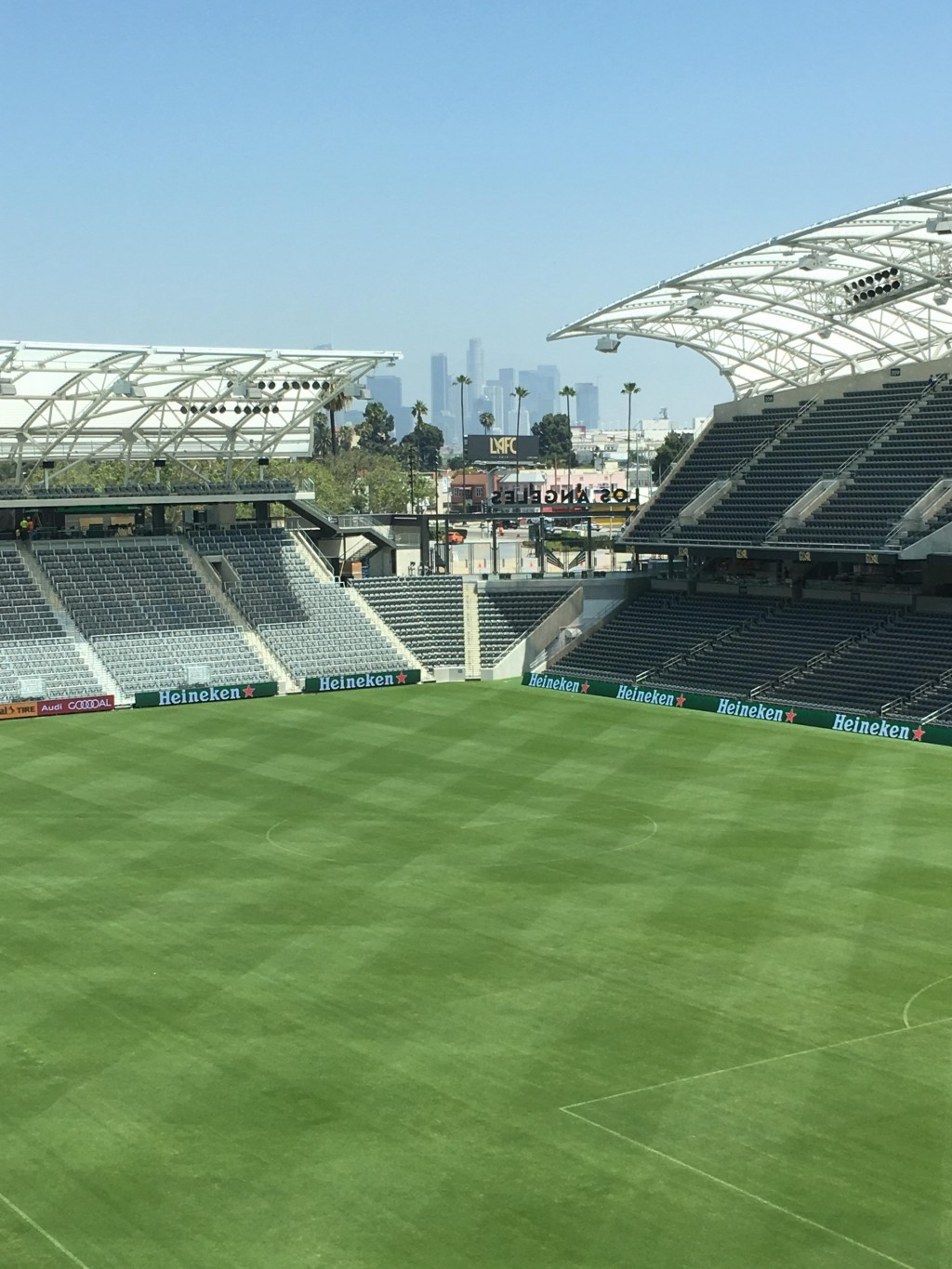 In this Thursday, April 26, 2018, photo workers prepare the playing field at Banc of California Stadium for its official opening Sunday, April 29, and...