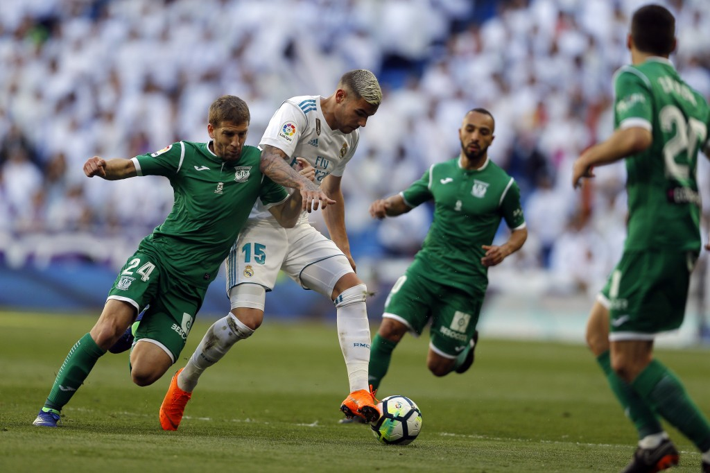 Real Madrid's Theo Hernandez, right, challenges Leganes' Darko Brasanac during a Spanish La Liga soccer match between Real Madrid and Leganes at the S...