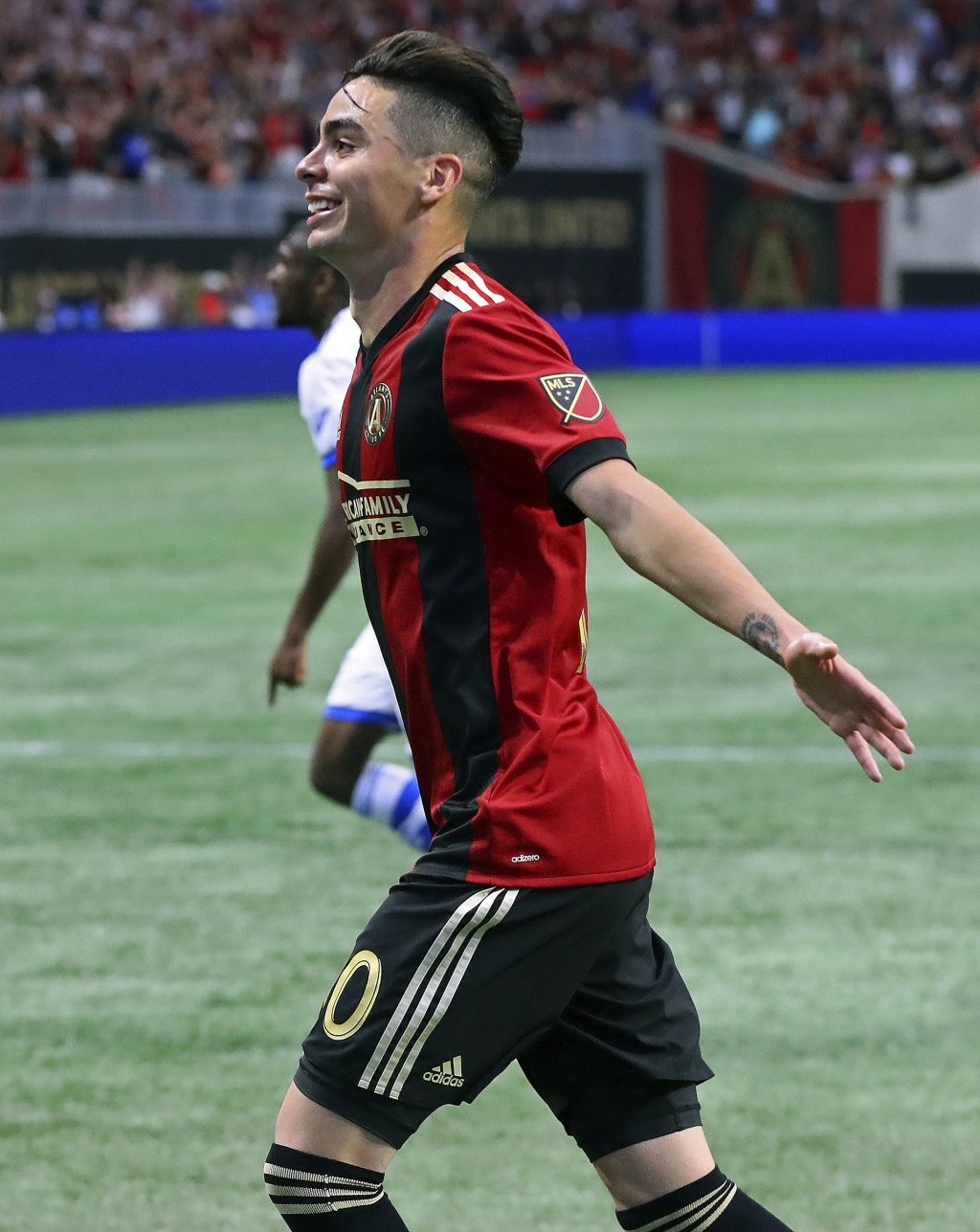 Atlanta United midfielder Miguel Almiron reacts to scoring a goal against Montreal Impact during the second half of an MLS soccer game on Saturday, Ap...