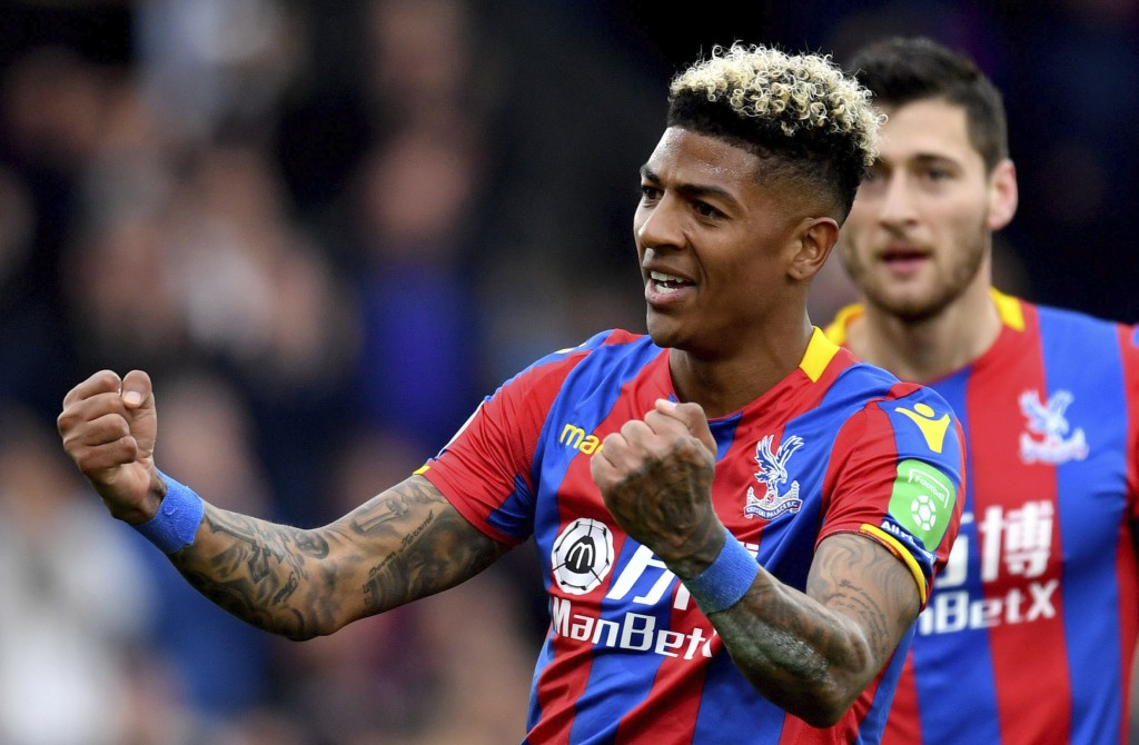 Crystal Palace's Patrick van Aanholt celebrates scoring his side's fourth goal of the game during their English Premier League soccer match Leicester ...