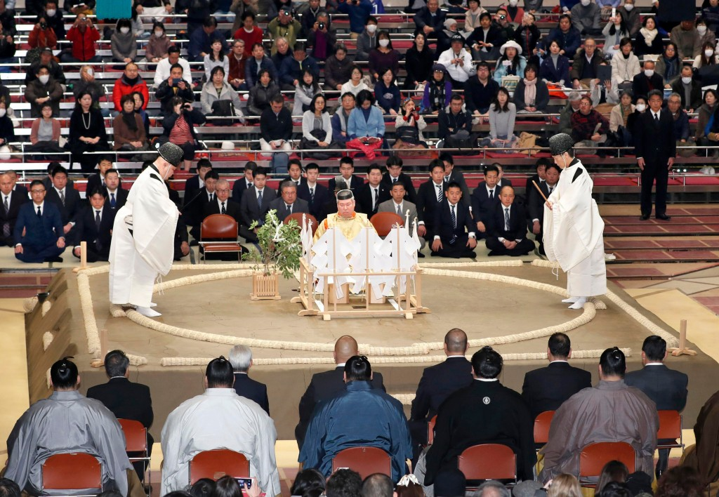 FILE - In this Nov. 11, 2017, file photo, a Shinto ceremony is held to pray for the safety of sumo wrestlers before the start of the Kyushu Grand Sumo...