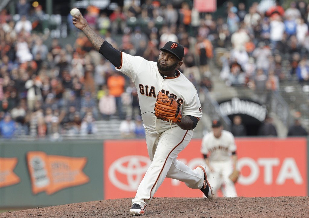 San Francisco Giants' Pablo Sandoval pitches against the San Francisco Giants during the ninth inning of a baseball game in San Francisco, Saturday, A...