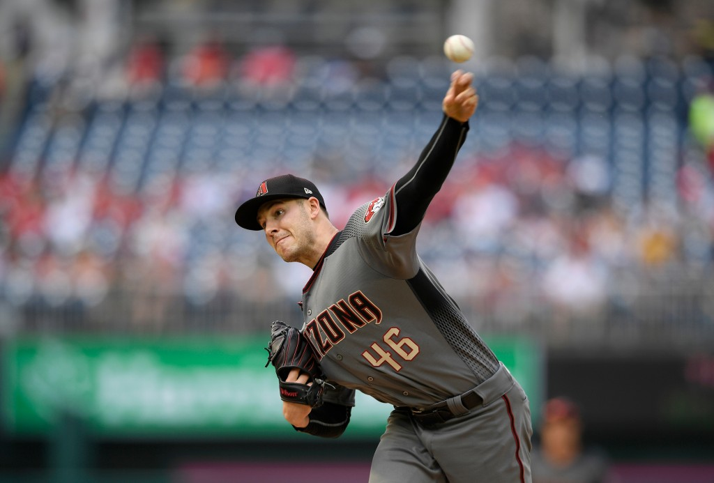 Arizona Diamondbacks starting pitcher Patrick Corbin delivers during the first inning of a baseball game against the Washington Nationals, Saturday, A...