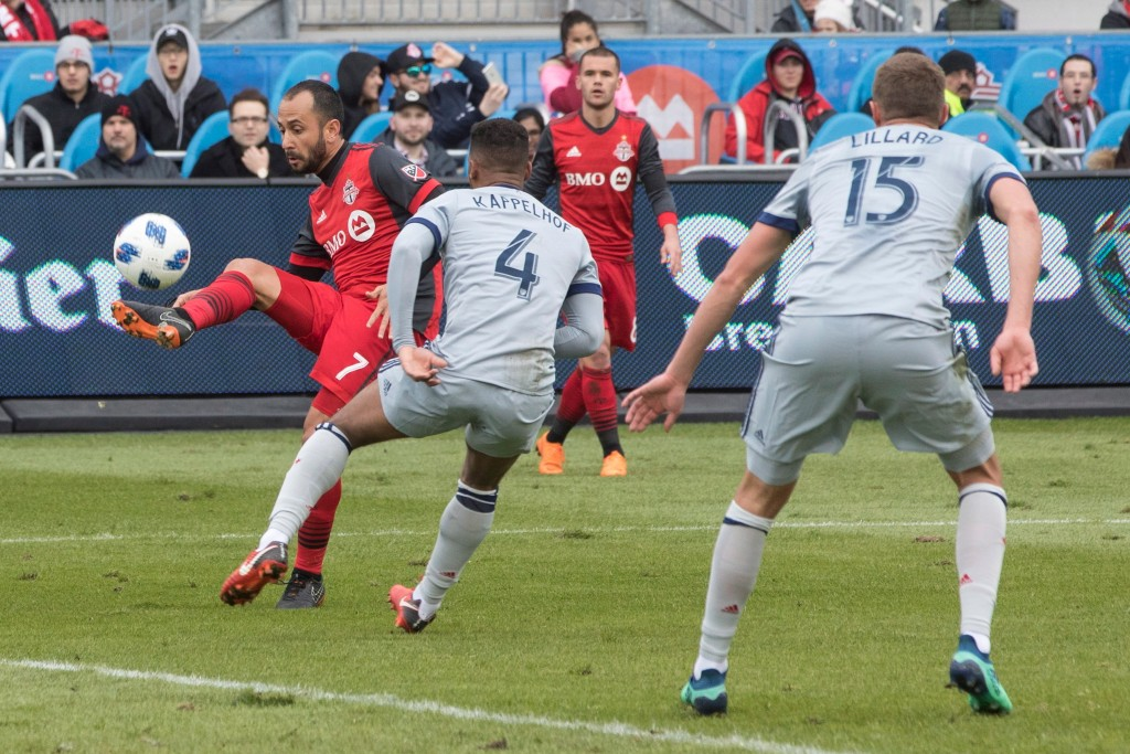Toronto FC's Victor Vazquez (left) scores against the Chicago Fire during first half MLS soccer action in Toronto on Saturday, April 28, 2018. (Chris ...