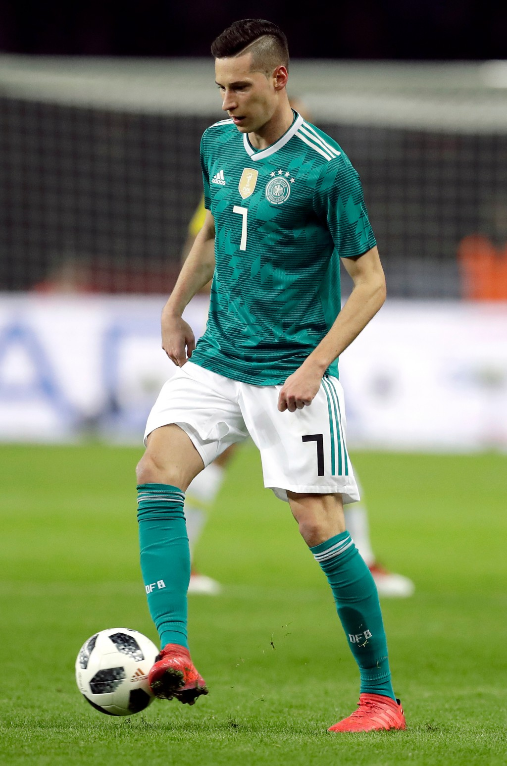 In this photo taken on Tuesday, March 27, 2018, Germany's Julian Draxler controls the ball during the international friendly soccer match between Germ...
