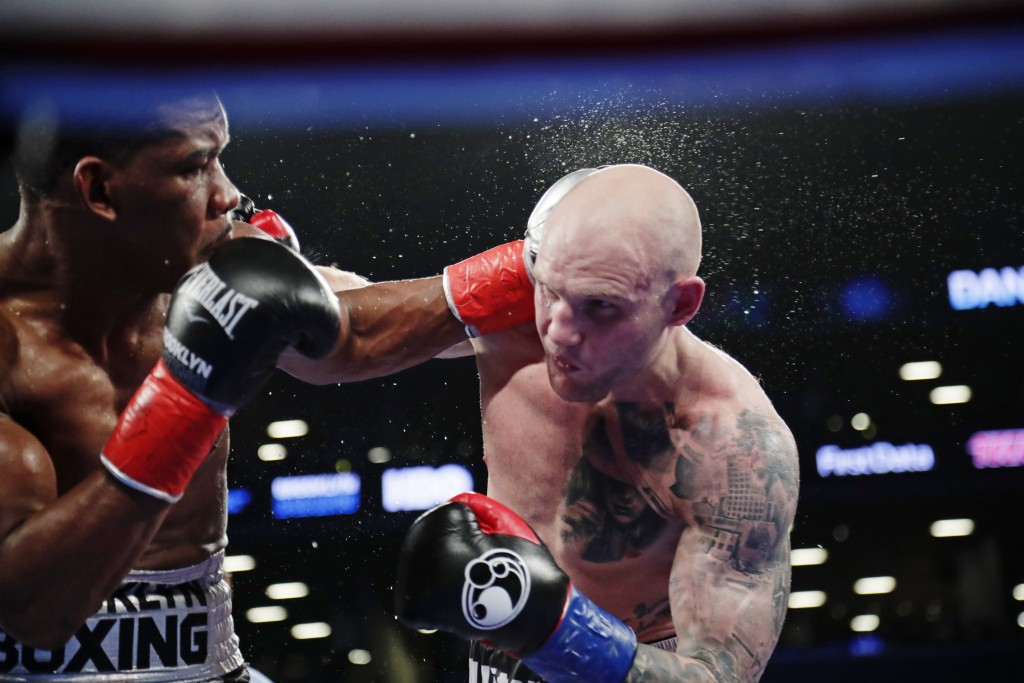 Daniel Jacobs, left, punches Poland's Maciej Sulecki during the 10th round of a middleweight boxing match Saturday, April 28, 2018, in New York. Jacob...