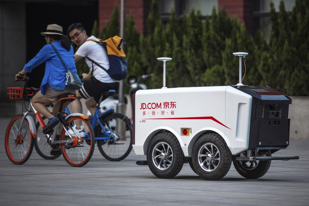 This undated image provided by JD.com shows an autonomous delivery vehicle. Dr. Hui Cheng, the head of robotics research at JD.'s Silicon Valley Resea...