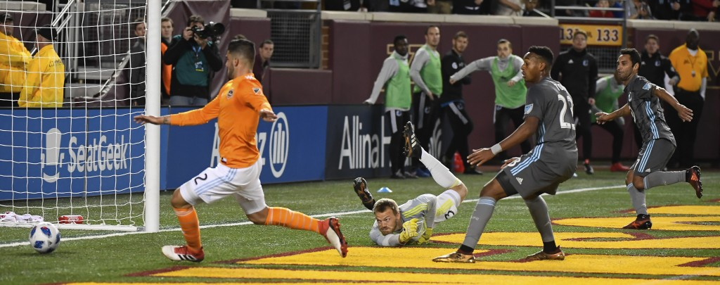 Minnesota United midfielder Ibson, right, scores a goal past Houston Dynamo goalkeeper Joe Willis, on ground, during the second half of an MLS soccer ...