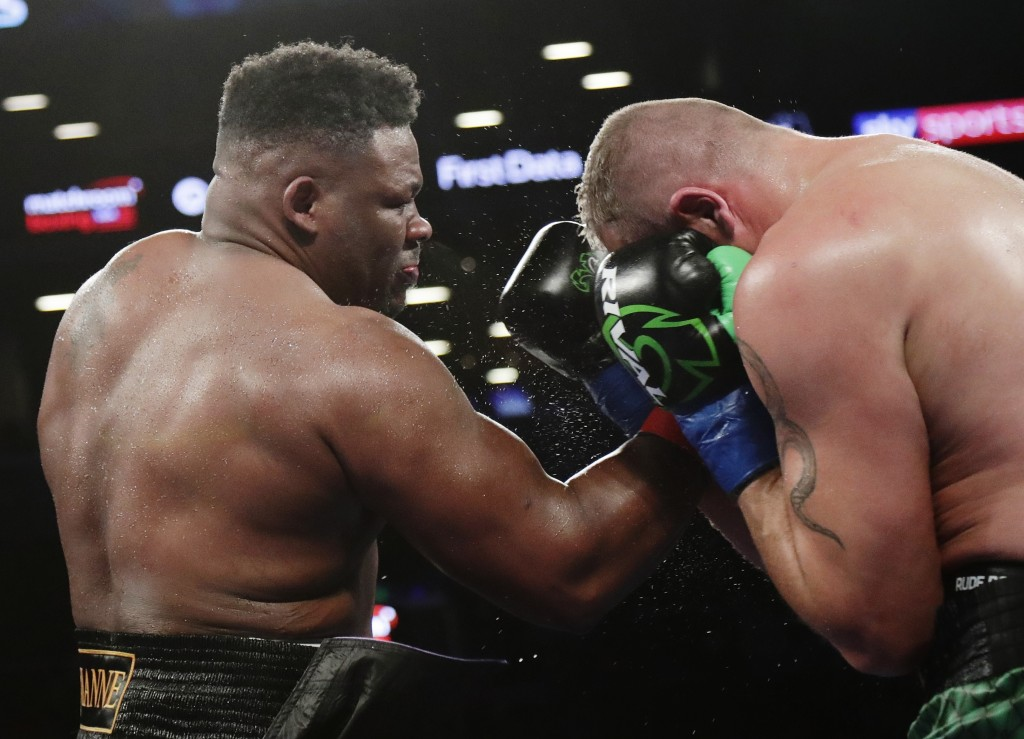 Jarrell Miller, left, punches Johann Duhaupas, of France, during the fifth round a heavyweight boxing match Saturday, April 28, 2018, in New York. Mil...
