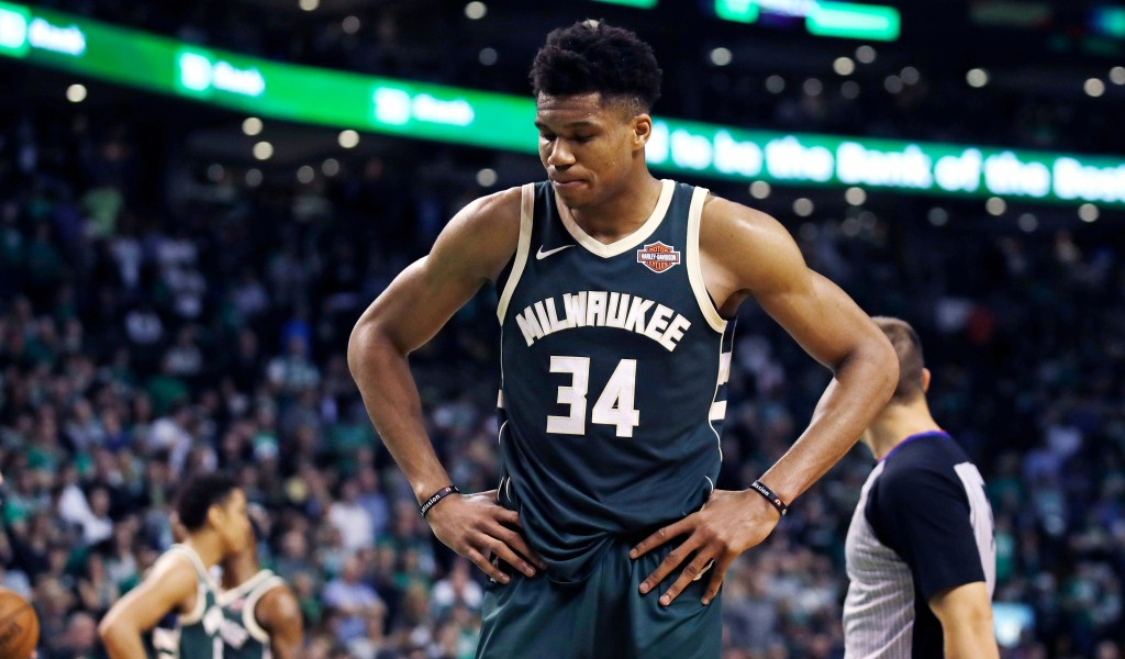 Milwaukee Bucks forward Giannis Antetokounmpo pauses after a basket by Boston Celtics guard Terry Rozier during the fourth quarter of Game 7 of an NBA...