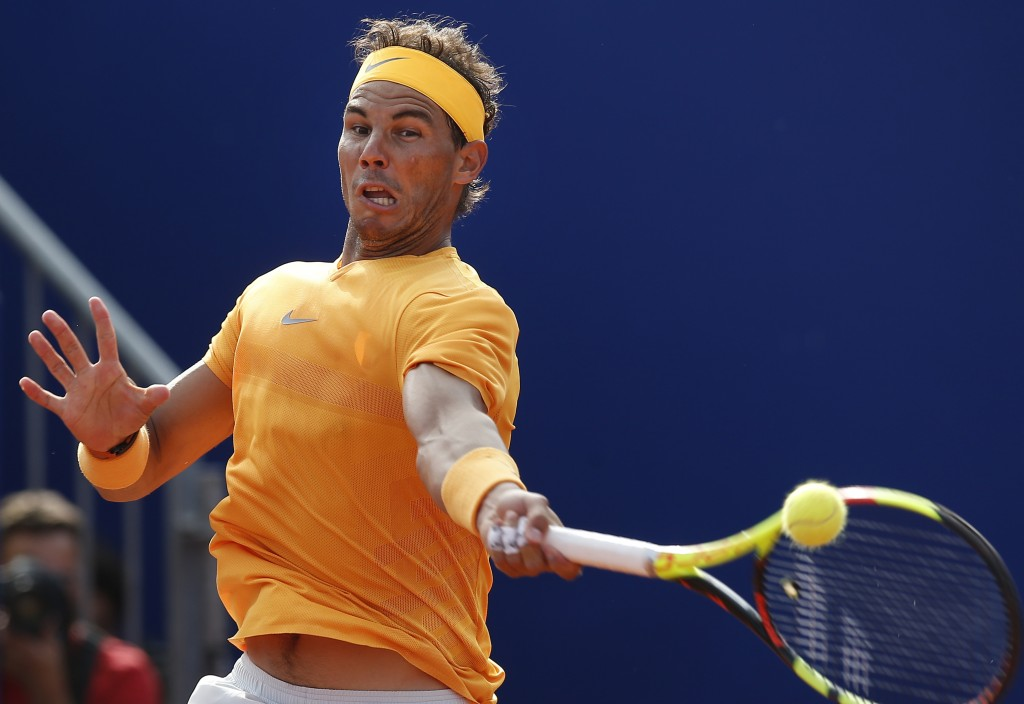 Spain's Rafael Nadal returns the ball in his semifinal match against Belgium's David Goffin during the Barcelona Open Tennis Tournament in Barcelona, ...