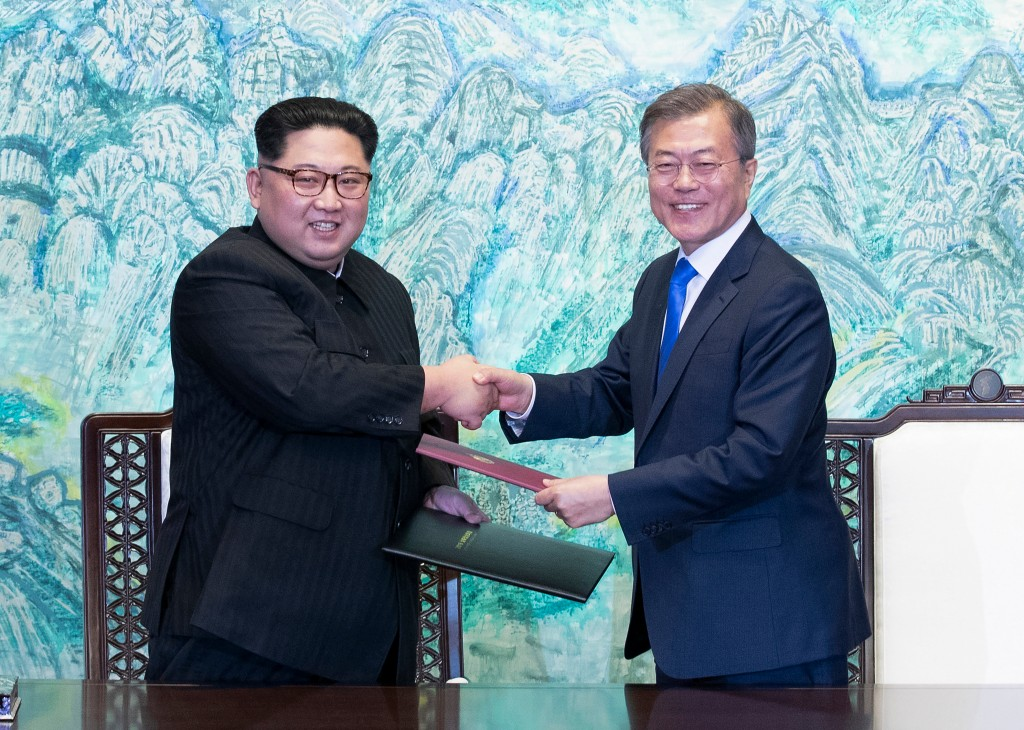 FILE - In this April 27, 2018 file photo, North Korean leader Kim Jong Un, left, and South Korean President Moon Jae-in shake hands after signing on a...