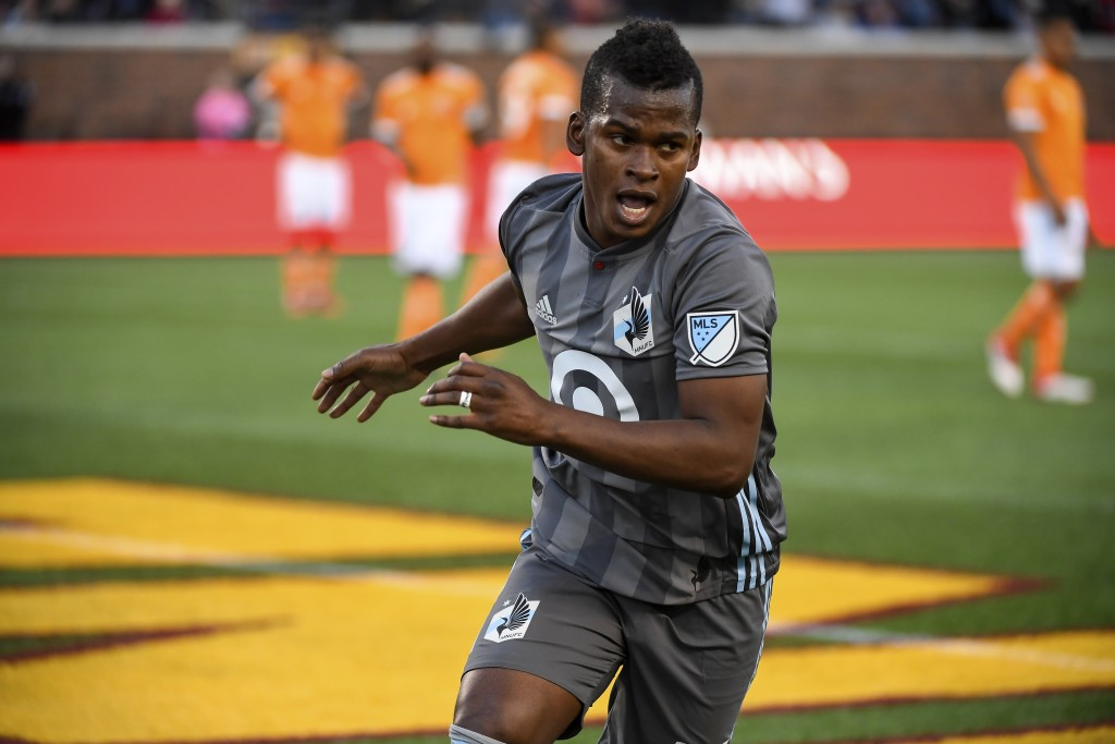 Minnesota United midfielder Darwin Quintero reacts after scoring a goal off a penalty kick against the Houston Dynamo in the first half of an MLS socc...