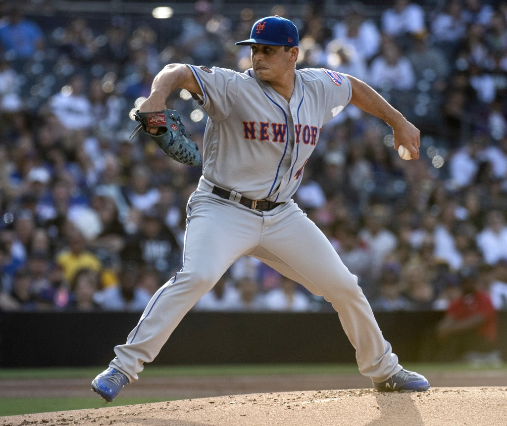 New York Mets starter Jason Vargas delivers a pitch during the first inning of the team' baseball game against the San Diego Padres in San Diego, Satu...