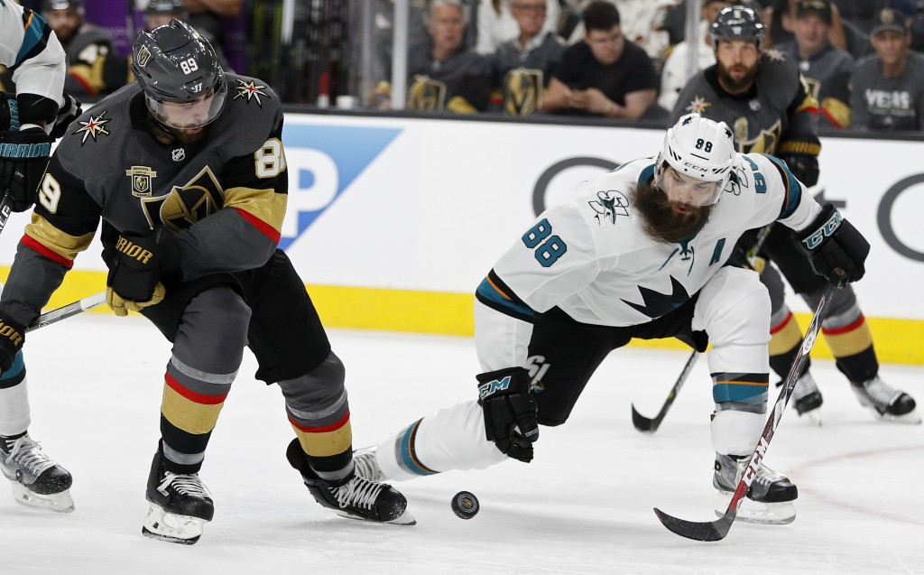 San Jose Sharks defenseman Brent Burns (88) and Vegas Golden Knights right wing Alex Tuch (89) vie for the puck during the second period of Game 2 of ...