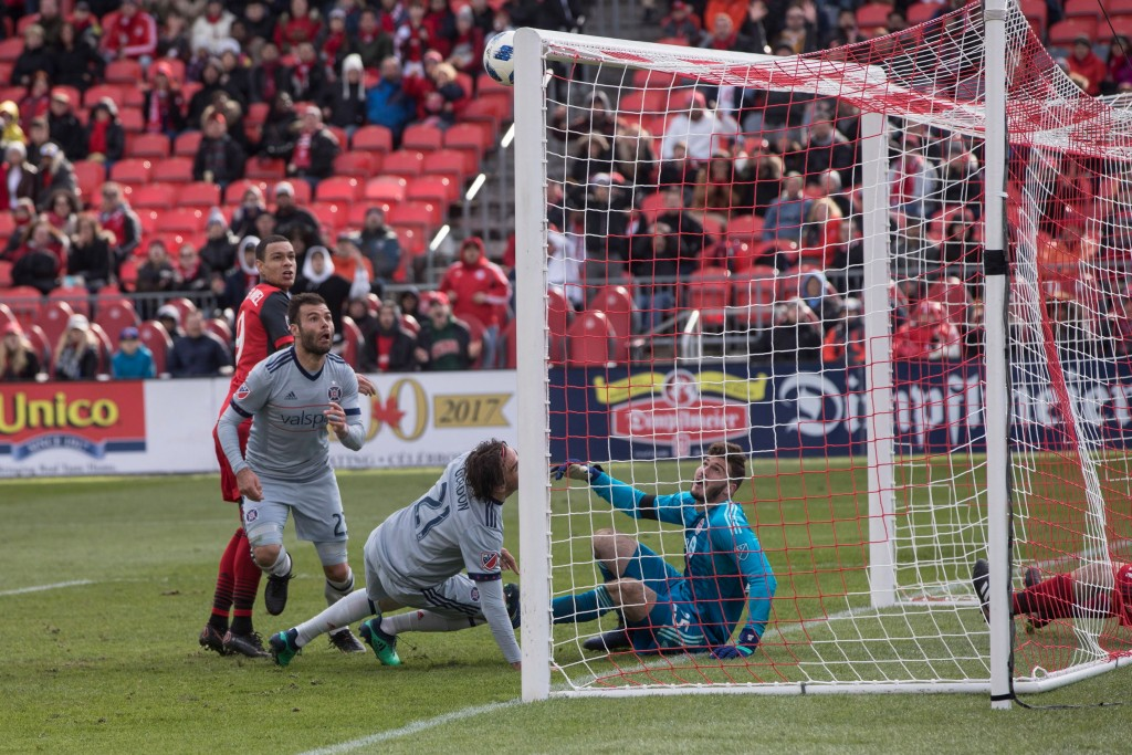 Chicago Fire forward Nemanja Nikolic (23) watches as his shot hit the crossbar while Toronto FC goalkeeper Alex Bono looks on during second-half MLS s...