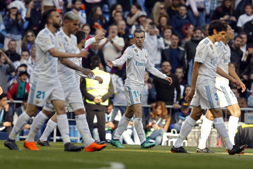 Real Madrid's Gareth Bale, centre, celebrates with teammates after scoring the opening goal against Leganes during a Spanish La Liga soccer match betw...