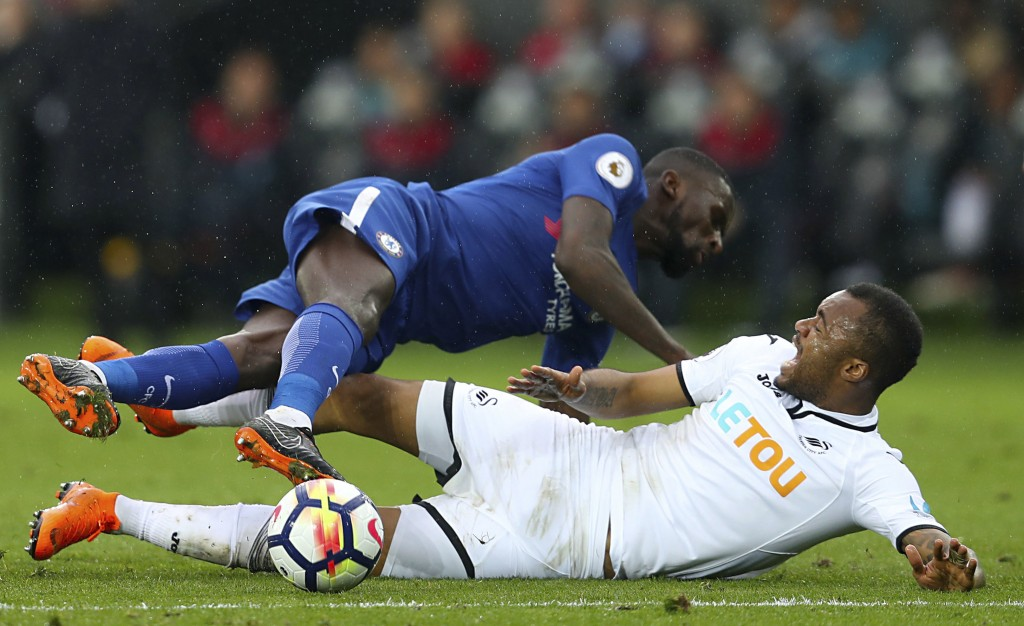Chelsea's Antonio Rudiger, top, and Swansea City's Jordan Ayew battle for the ball during their English Premier League soccer match at the Liberty Sta...