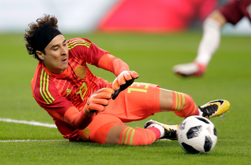 In this image taken on Tuesday, March 27, 2018 Mexico goalkeeper Guillermo Ochoa makes a save a shot by Croatia in the first half of a friendly soccer...