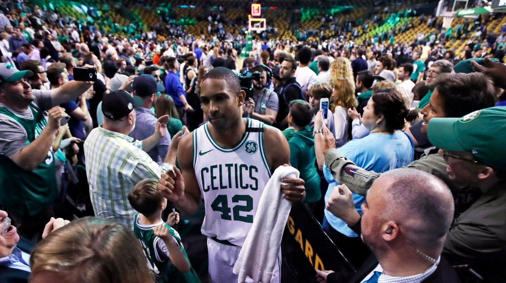 Boston Celtics forward Al Horford (42) wades through a crowd of supports after the Celtics defeated the Milwaukee Bucks in Game 7 of an NBA basketball...