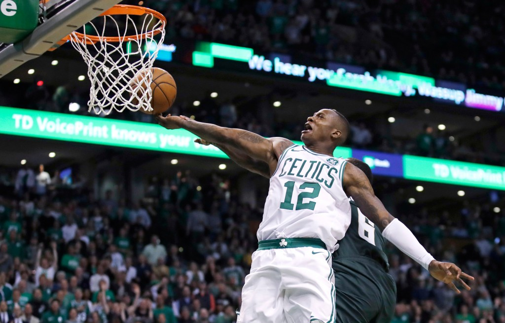 Boston Celtics guard Terry Rozier (12) drives to the basket against the Milwaukee Bucks during the fourth quarter of Game 7 of an NBA basketball first...