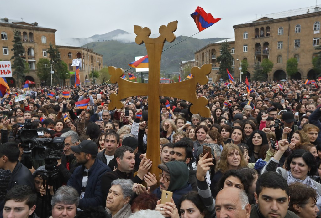 Protesters react while listening to their leader Nikol Pashinian in the town of Vanadzor, Armenia, Saturday, April 28, 2018. Armenia's ruling party sa...