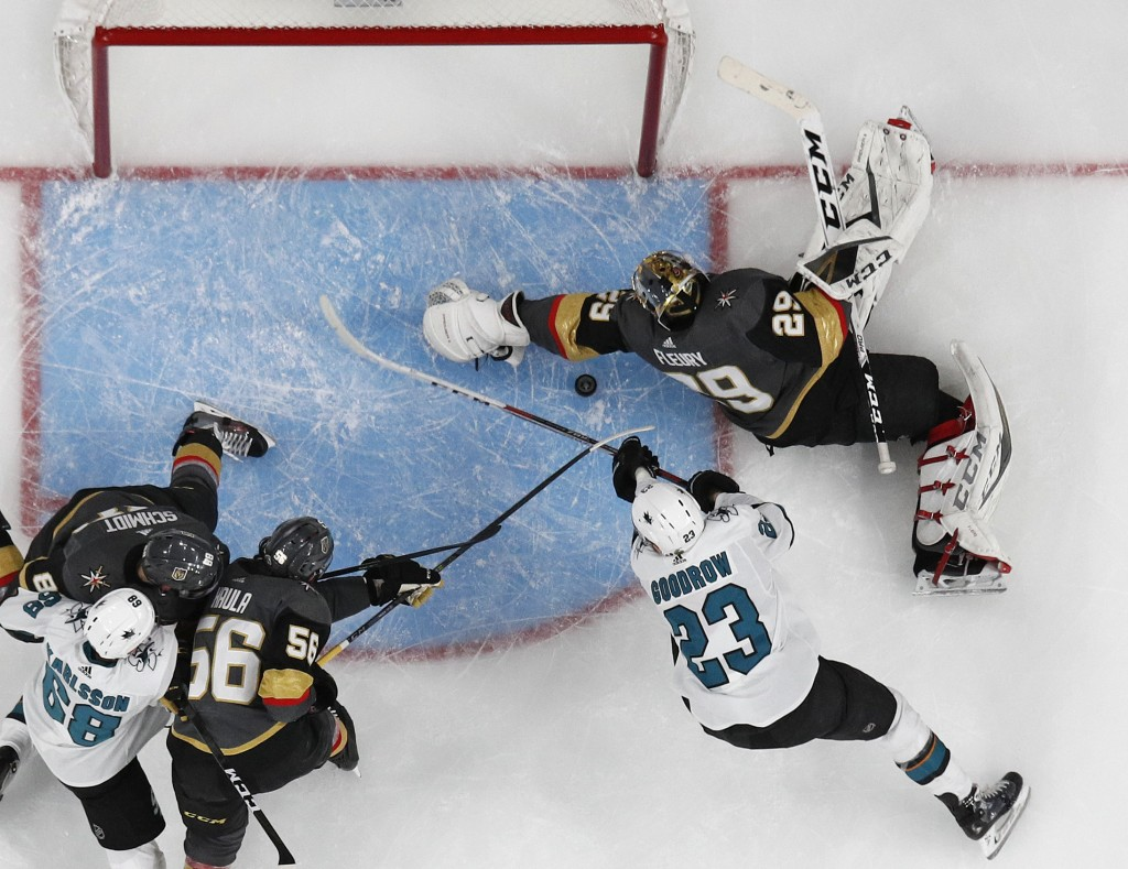 Vegas Golden Knights goaltender Marc-Andre Fleury (29) blocks a shot by San Jose Sharks right wing Barclay Goodrow (23) during the second period of Ga...