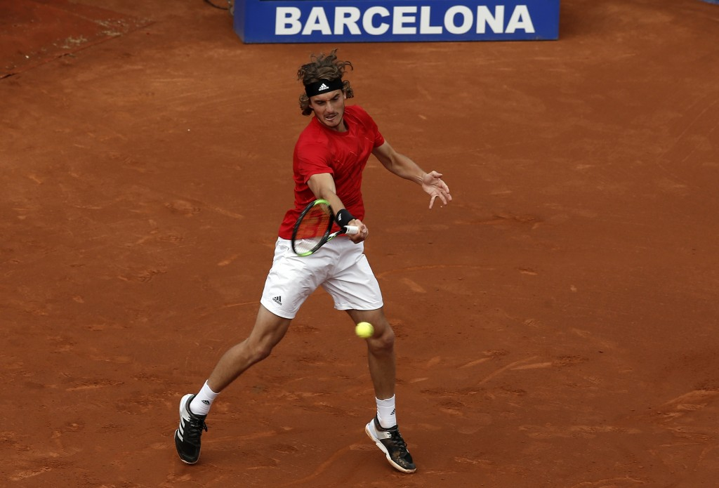 Greece's Stefanos Tsitsipas returns the ball to Spain's Rafael Nadal during the Barcelona Open Tennis Tournament final in Barcelona, Spain, Sunday, Ap...