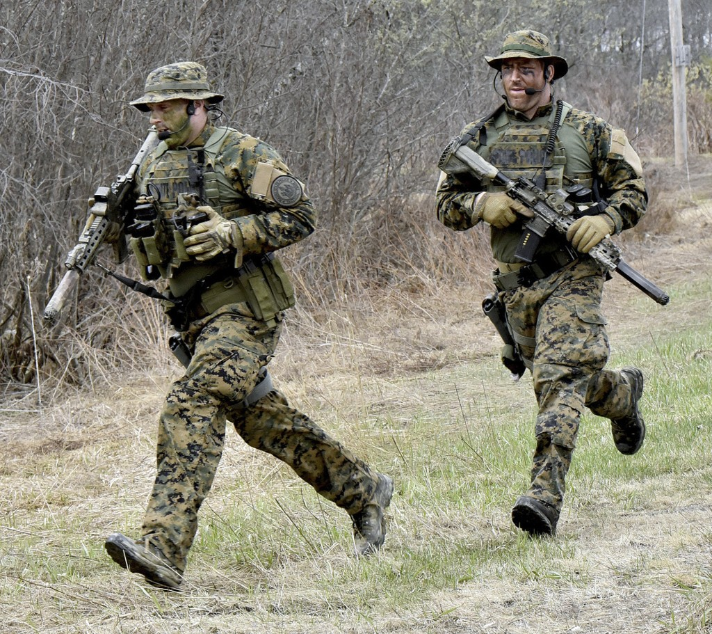 Police run to the scene where suspect John Williams was apprehended during a manhunt on Saturday, April 28, 2018, in Fairfield, Maine. The Maine Depar...