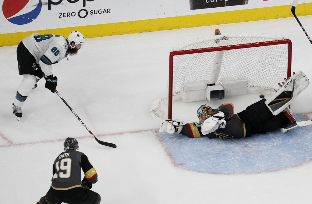 San Jose Sharks defenseman Brent Burns (88) scores against Vegas Golden Knights goaltender Marc-Andre Fleury, right, during the second period of Game ...