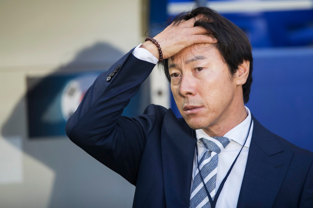 In this photo taken on Saturday, Oct. 7, 2017, South Korea's head coach Shin Tae-Yong waits for the kick-off of the international friendly soccer matc...