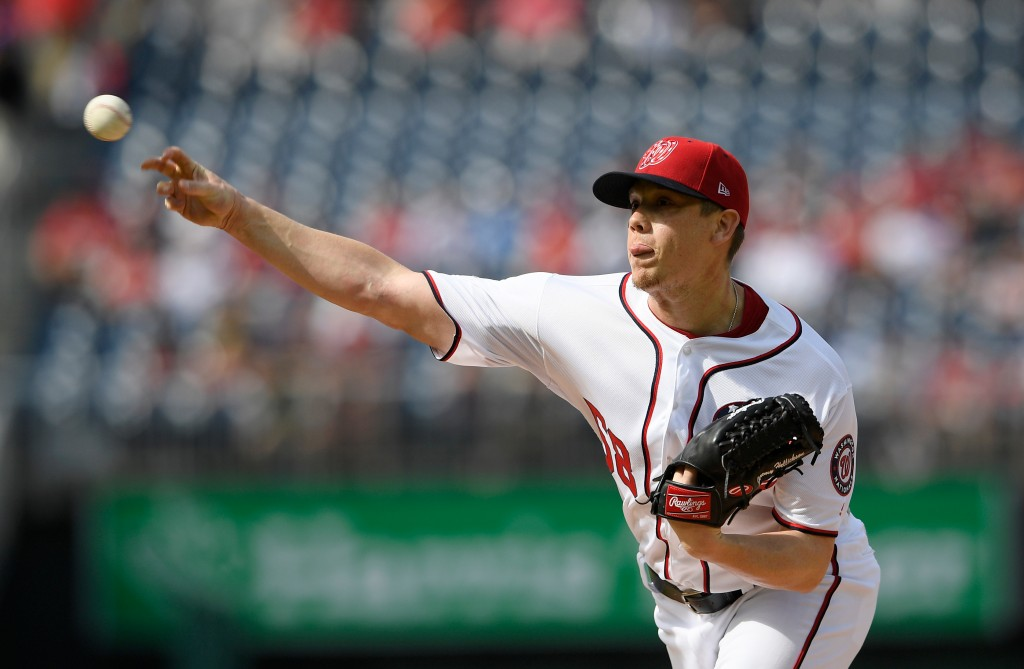 Washington Nationals starting pitcher Jeremy Hellickson delivers a pitch during the first inning of a baseball game against the Arizona Diamondbacks, ...