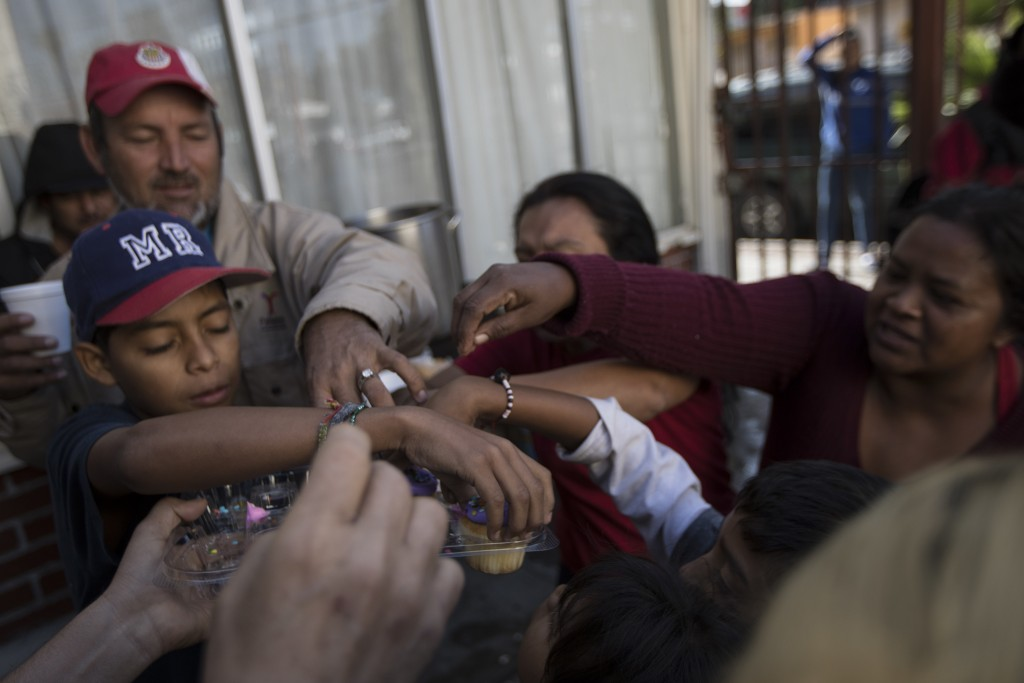 """Migrants have their breakfast at the """"Vina de Tijuana AC"""" migrant shelter in Tijuana, Mexico, Saturday, April 28, 2018. As the migrants prepare to wal..."""