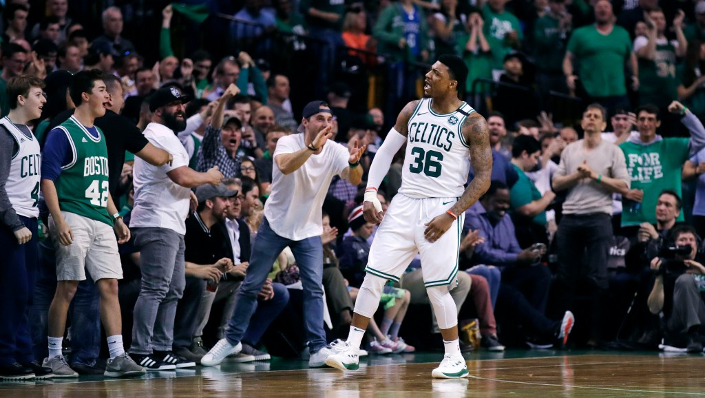 Boston Celtics guard Marcus Smart (36) celebrates a basket with fans during the second quarter of Game 7 of an NBA basketball first-round playoff seri...