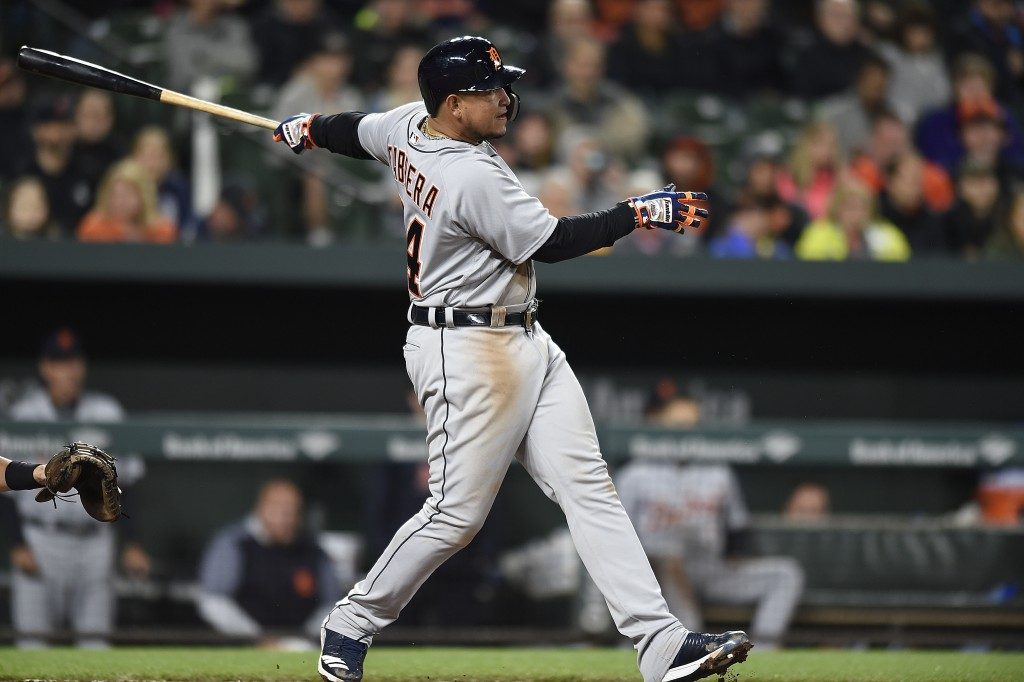 Detroit Tigers' Miguel Cabrera follows through on a two-run double against the Baltimore Orioles in the fourth inning of baseball game, Saturday, Apri...