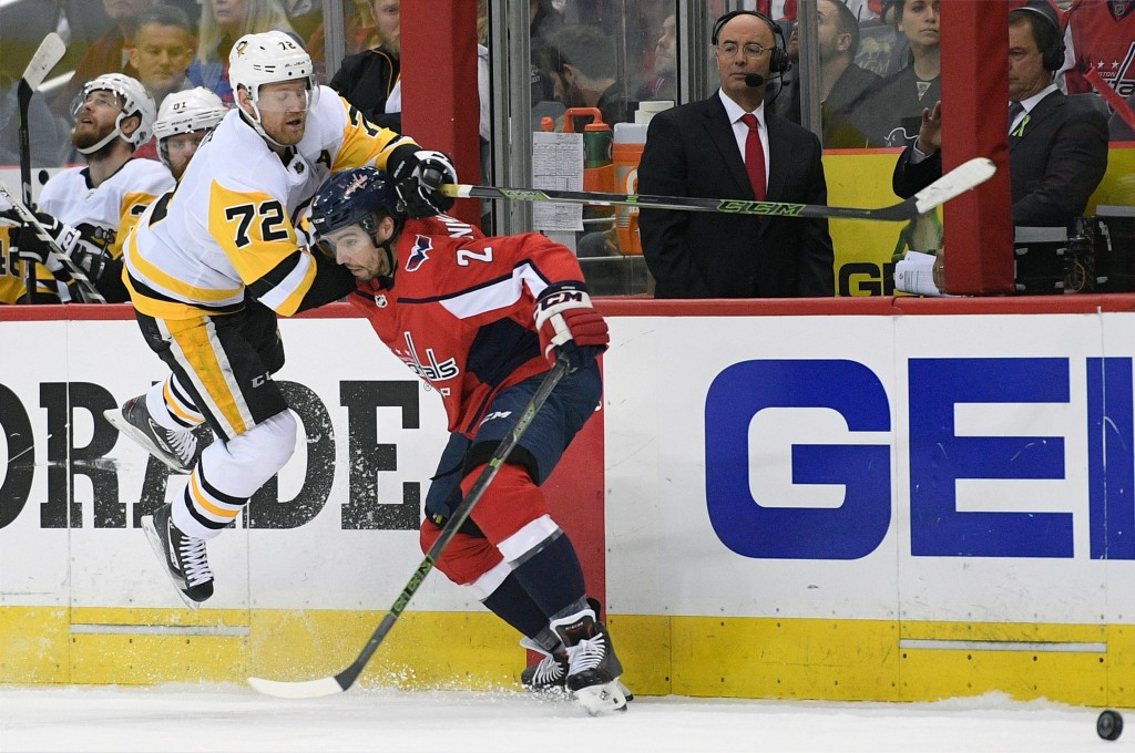 Pittsburgh Penguins right wing Patric Hornqvist (72), of Sweden, battles for the puck against Washington Capitals defenseman Matt Niskanen (2) during ...
