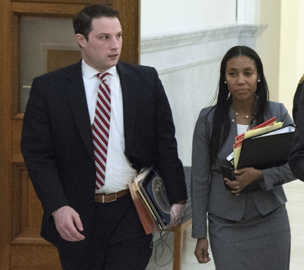 FILE - In this Tuesday, Feb. 2, 2016, file photo, M. Stewart Ryan, left, and Kristen Feden leave court after a pretrial hearing for Bill Cosby, in Nor...