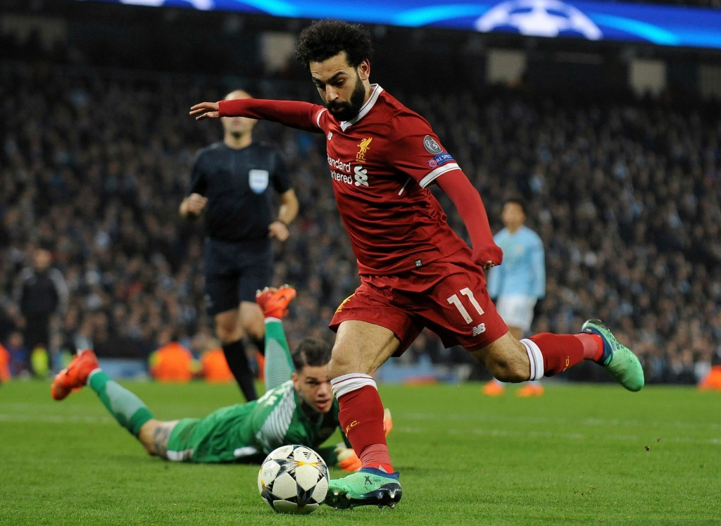 FILE - In this April 10, 2018, file photo, Liverpool's Mohamed Salah scores his side's first goal during the Champions League quarterfinal second leg ...