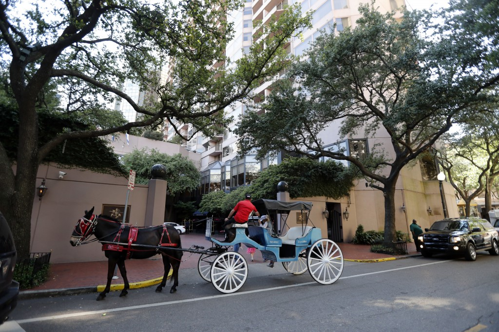 This April 27, 2018 photo shows a horse and carriage in front of The Windsor Court Hotel in New Orleans. Hotels are getting in on royal wedding mania ...