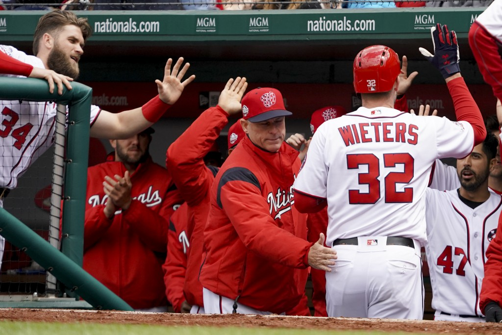 Washington Nationals catcher Matt Wieters (32) high-fives teammates after hitting a home run during the second inning of a baseball game against the A...