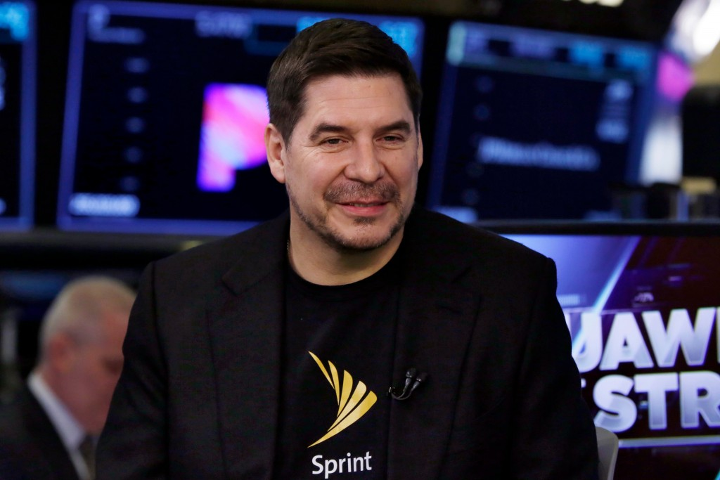 Sprint CEO Marcelo Claure is interviewed on the floor of the New York Stock Exchange, Monday, April 30, 2018. To gain approval for their $26.5 billion...
