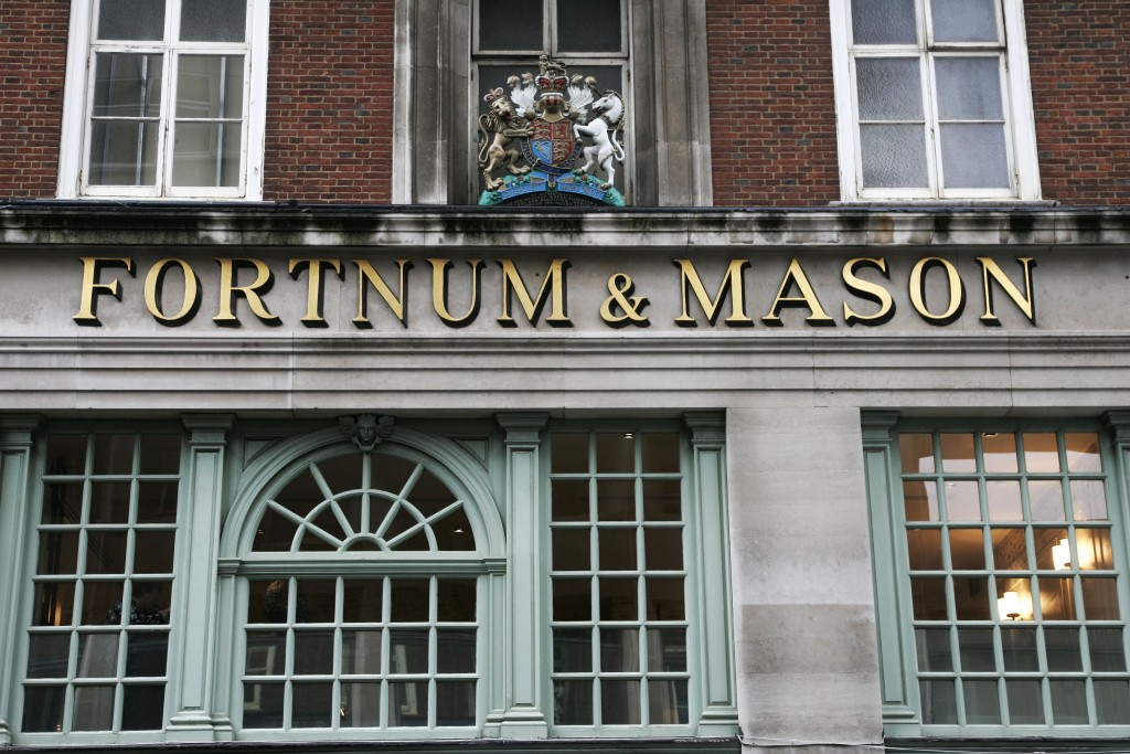 FILE - This Jan. 28, 2009, file photo, shows the Fortnum & Mason store in London, also bearing the Royal Coat of Arms above, declaring by appointment ...