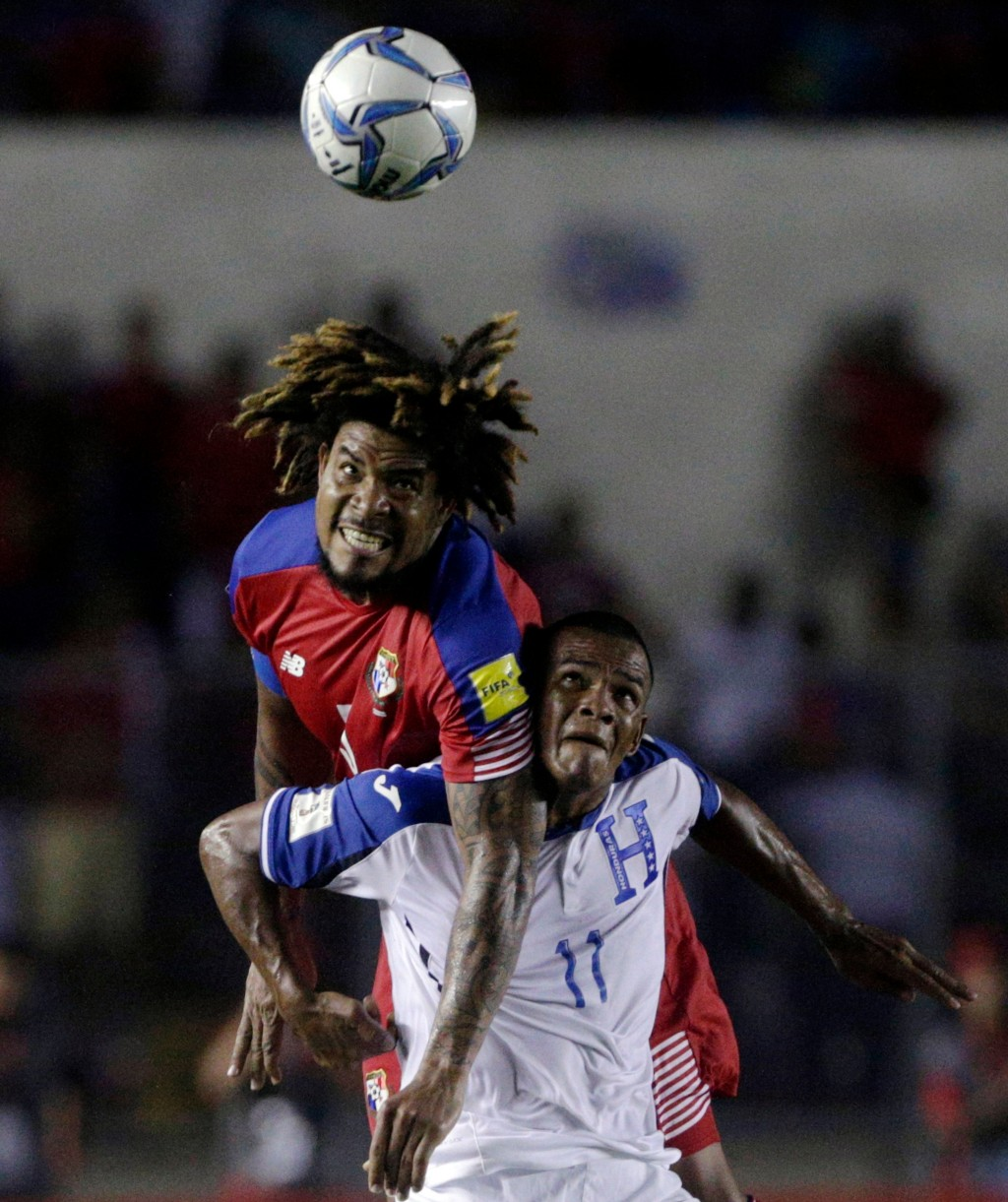 FILE - In this Tuesday, June 13, 2017 filer, Panama's Roman Torres, top, and Honduras' Rony Martinez vie for the ball during a 2018 Russia World Cup q...