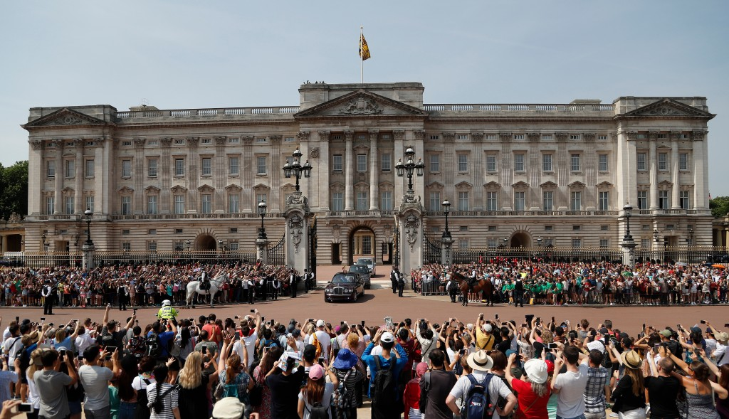 FILE- In this Wednesday, June 21, 2017, file photo, Queen Elizabeth II leaves Buckingham Palace with Prince Charles to travel to parliament for her sp...