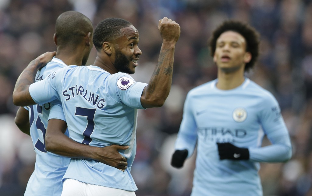 Manchester City's Raheem Sterling, celebrates after teammate Manchester City's Fernandinho, left, scored his side's forth goal during the English Prem...