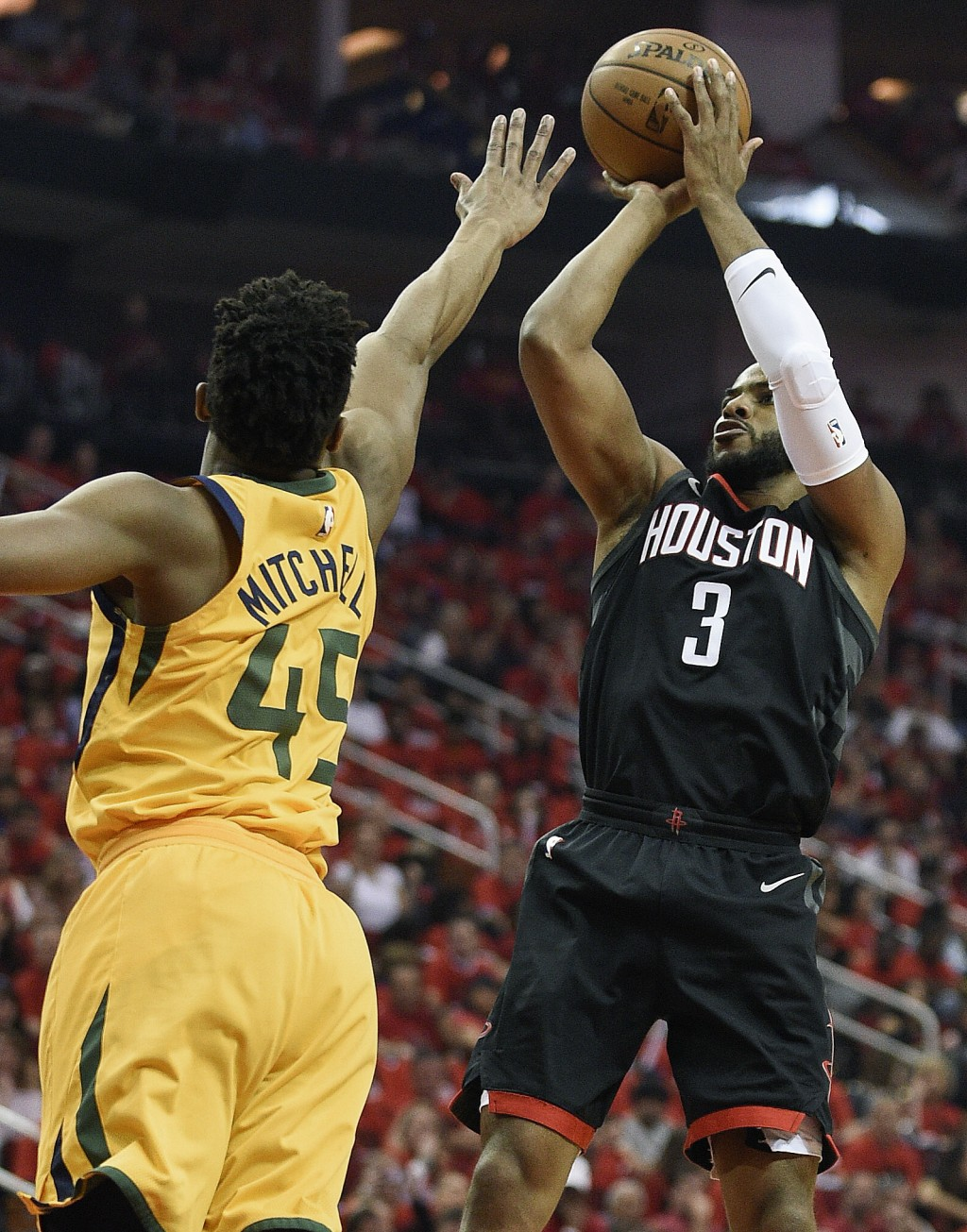 Houston Rockets guard Chris Paul (3) shoots over Utah Jazz guard Donovan Mitchell during the first half in Game 1 of an NBA basketball second-round pl...
