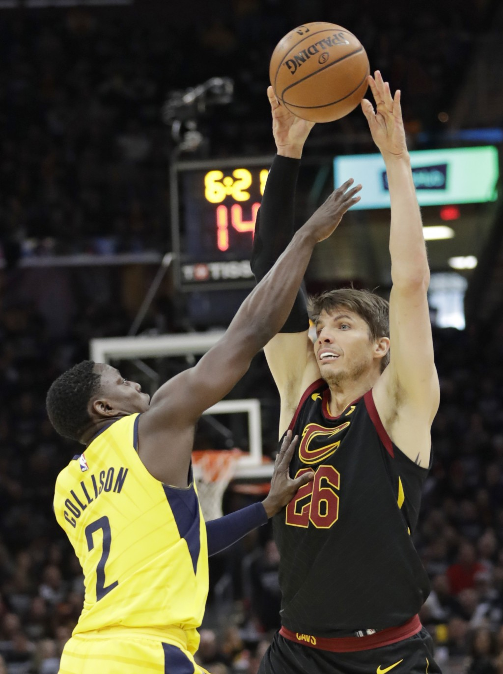 Cleveland Cavaliers' Kyle Korver (26) passes over Indiana Pacers' Darren Collison (2) in the first half of Game 7 of an NBA basketball first-round pla...