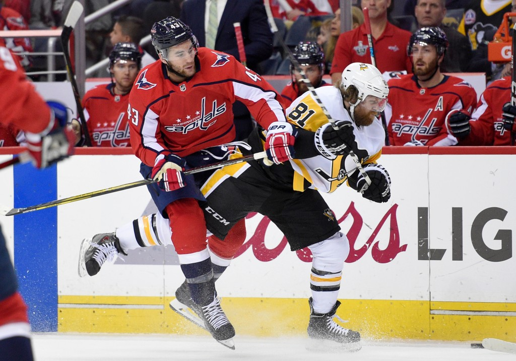 Washington Capitals right wing Tom Wilson (43) collides with Pittsburgh Penguins right wing Phil Kessel (81) during the first period in Game 2 of an N...
